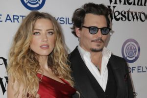 CULVER CITY, CA - JANUARY 09: Actors Amber Heard (L) and Johnny Depp attend The Art of Elysium 2016 HEAVEN Gala presented by Vivienne Westwood & Andreas Kronthaler at 3LABS on January 9, 2016 in Culver City, California. (Photo by Alison Buck/Getty Images)